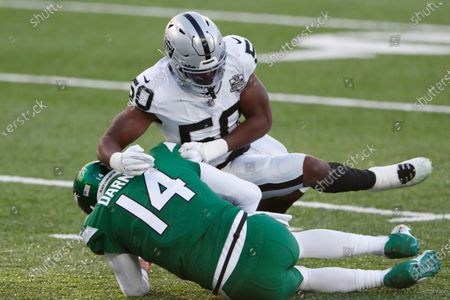 Stock Picture of Las Vegas Raiders' Nicholas Morrow, top, sacks New York Jets quarterback Sam Darnold during the second half an NFL football game, in East Rutherford, N.J