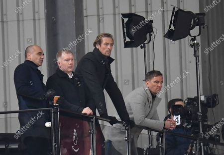 Belgium national soccer team head coach Roberto Martinez (L), former English soccer players Paul Scholes (2-L) and Peter Crouch (2-R) in the the commentator area during the English Premier League soccer match between Liverpool FC and Wolverhampton Wanderers in Liverpool, Britain, 06 December 2020.