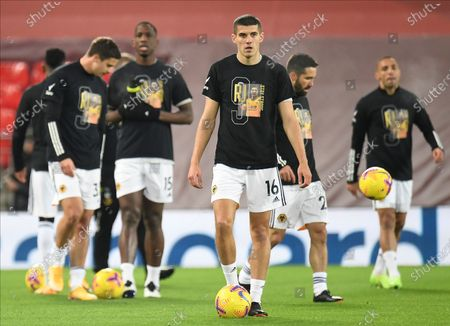 Wolverhampton's Conor Coady wears a number 9 shirt in honour of injured team-mate Raul Jimenez during the warm-up ahead the English Premier League soccer match between Liverpool FC and Wolverhampton Wanderers in Liverpool, Britain, 06 December 2020.