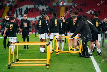 Wolverhampton players wear a number 9 shirt in honour of injured team-mate Raul Jimenez during the warm-up ahead the English Premier League soccer match between Liverpool FC and Wolverhampton Wanderers in Liverpool, Britain, 06 December 2020.