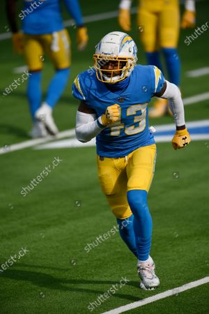 Los Angeles Chargers cornerback Michael Davis warms up before an NFL football game against the New England Patriots, in Inglewood, Calif