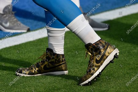 Los Angeles Chargers defensive end Joey Bosa wears colorful cleats as he warms up before an NFL football game against the New England Patriots, in Inglewood, Calif
