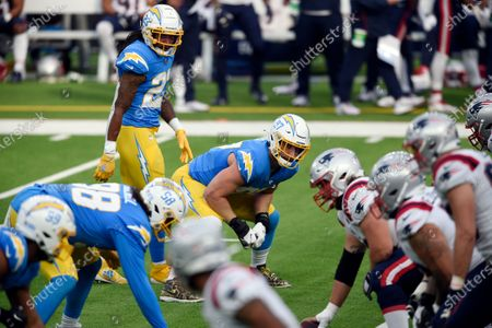 Los Angeles Chargers defensive end Joey Bosa, center, readies to rush during the first half of an NFL football game against the New England Patriots, in Inglewood, Calif