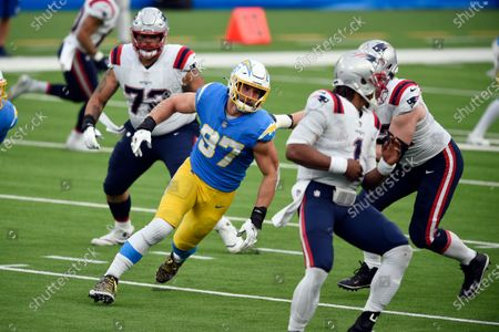 Los Angeles Chargers defensive end Joey Bosa (97) works against the New England Patriots during the first half of an NFL football game, in Inglewood, Calif