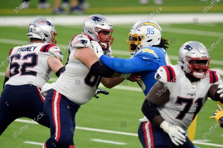 Los Angeles Chargers defensive tackle Linval Joseph (95) is blocked by New England Patriots center David Andrews during the second half of an NFL football game, in Inglewood, Calif
