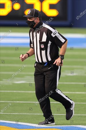 Umpire Rich Hall (49) jogs with the play during an NFL football game between the New England Patriots and the Los Angeles Chargers, in Inglewood, Calif