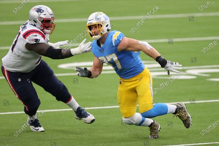 Los Angeles Chargers defensive end Joey Bosa (97) rushes the passer as New England Patriots offensive tackle Mike Onwenu (71) blocks during an NFL football game, in Inglewood, Calif