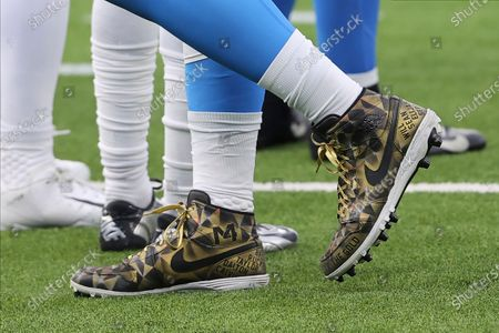 Los Angeles Chargers defensive end Joey Bosa (97) wears his MCMC cleats during an NFL football game against the New England Patriots, in Inglewood, Calif