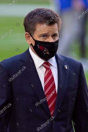 Arizona Cardinals owner Michael Bidwill walks on the field prior to an NFL football game against the Los Angeles Rams, in Glendale, Ariz