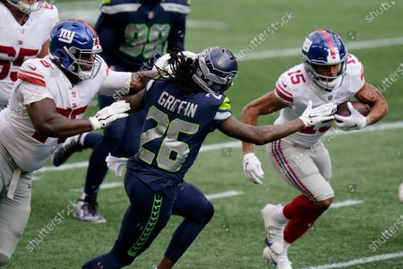 Seattle Seahawks cornerback Shaquill Griffin (26) moves to tackle New York Giants wide receiver Golden Tate (15) as New York Giants offensive tackle Cameron Fleming, left, moves in, during the first half of an NFL football game, in Seattle