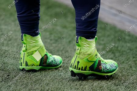 Stock Picture of Seattle Seahawks quarterback Russell Wilson wears custom cleats with the name of Bronna Taylor and other victims of police brutality in support of Black Lives Matter as he warms up for an NFL football game against the New York Giants, in Seattle
