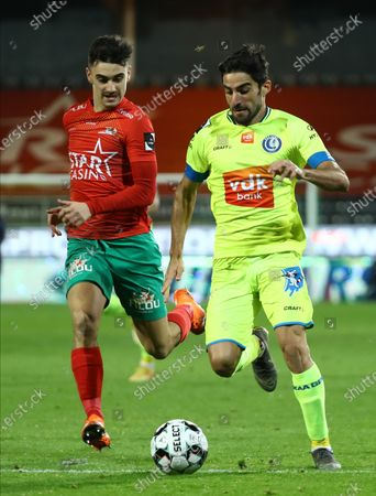 Oostende's Jelle Bataille and Gent's Milad Mohammadi fight for the ball during a soccer match between KV Oostende and KAA Gent, Sunday 06 December 2020 in Oostende, on the fifteenth day of the 'Jupiler Pro League' first division of the Belgian championship.