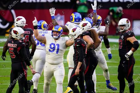 Los Angeles Rams defensive tackle Greg Gaines (91) cheers after Arizona Cardinals kicker Zane Gonzalez (5) missed a field goal during the first half of an NFL football game, in Glendale, Ariz