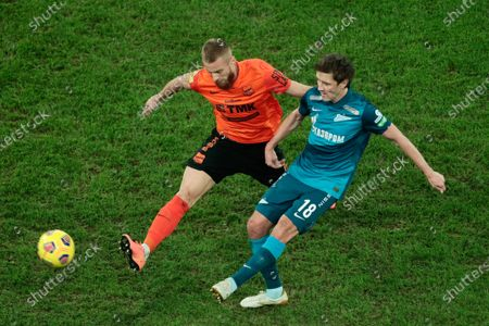 Stock Photo of midfielder Rafal Augustyniak of FC Ural and midfielder Yuri Zhirkov of FC Zenit in action