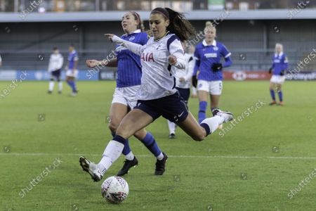 Stock Photo of Alex Morgan of Tottenham shoots during the womens super league game between Tottenham and Brighton at the Hive in London.