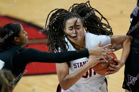 Stock Picture of Stanford's Haley Jones, right, drives around Washington's Alexis Whitfield during the second half of an NCAA women's college basketball game, in Las Vegas