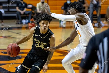 Stock Image of Oklahoma State's Bryce Williams guards Oakland's Jalen Moore during the first quarter of the NCAA college basketball game in Stillwater, Okla