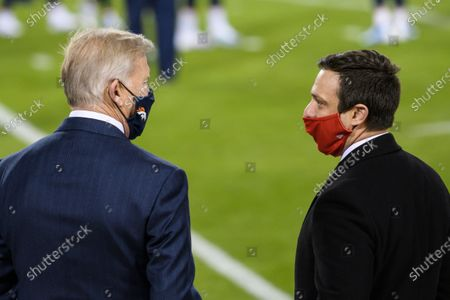 General Mangers John Elway of the Denver Broncos, left, and Brett Veach of the Kansas City Chiefs chat before an NFL football game between their teams, in Kansas City, Mo