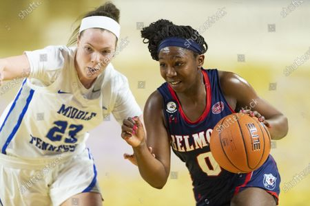 Stock Photo of Belmont guard Tuti Jones (0) drives as Middle Tennessee State guard Alexis Whittington (23) defends during an NCAA basketball game, in Murfreesboro, Tenn
