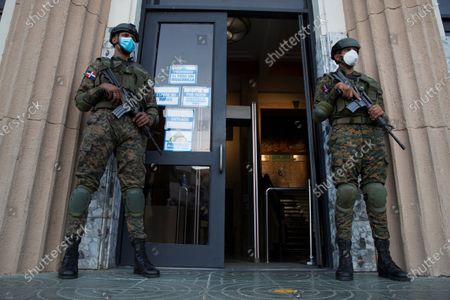 Soldiers stand guard at the entrance to the Dominican Justice Palace during a hearing on the case of an alleged corruption structure that stole 81 million US dollars from the public treasury, in Santo Domingo, Dominican Republic, 06 December 2020. The Prosecutor's Office launched an operation against officials of the past Government and state suppliers, which led to the arrest of ten people, including two brothers of the former President Danilo Medina, Juan Alexis Medina and Carmen Magalys Medina.
