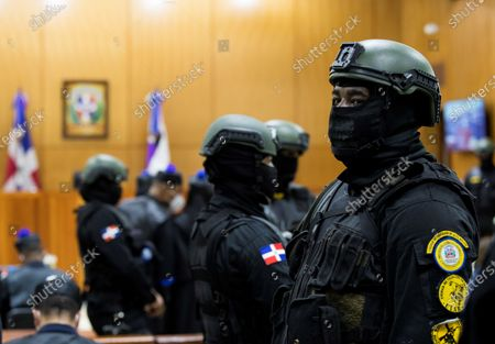 Police officers stand guard during a hearing on the case of an alleged corruption structure that stole 81 million US dollars from the public treasury, in Santo Domingo, Dominican Republic, 06 December 2020. The Prosecutor's Office launched an operation against officials of the past Government and state suppliers, which led to the arrest of ten people, including two brothers of the former President Danilo Medina, Juan Alexis Medina and Carmen Magalys Medina.