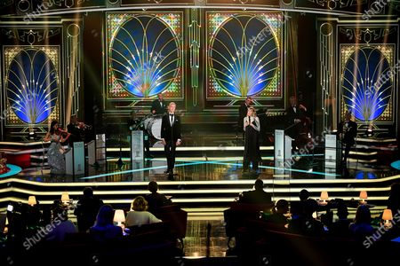 Stock Image of German singer Max Raabe (C-L) and Lea-Marie Becker (C-R) perform on stage during the 'Ein Herz Fuer Kinder' (lit: A Heart for Children) gala show in Berlin, Germany, 05 December 2020. German television channel ZDF and newspaper 'Bild' collected donations for children's charity organizations in Germany and the whole world.