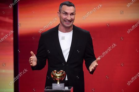 Former Ukrainian boxing heavyweight champion Wladimir Klitschko reacts as he is honored with the golden heart for his extraordinary commitment to children during the 'Ein Herz Fuer Kinder' (lit: A Heart for Children) gala show in Berlin, Germany, 05 December 2020. German television channel ZDF and newspaper 'Bild' collected donations for children's charity organizations in Germany and the whole world.