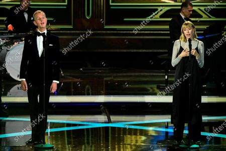 German singer Max Raabe (L) and Lea-Marie Becker (R) perform on stage during the 'Ein Herz Fuer Kinder' (lit: A Heart for Children) gala show in Berlin, Germany, 05 December 2020. German television channel ZDF and newspaper 'Bild' collected donations for children's charity organizations in Germany and the whole world.