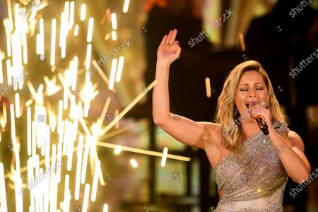 Stock Photo of German singer Helene Fischer performs on stage during the 'Ein Herz Fuer Kinder' (lit: A Heart for Children) gala show in Berlin, Germany, 05 December 2020. German television channel ZDF and newspaper 'Bild' collected donations for children's charity organizations in Germany and the whole world.