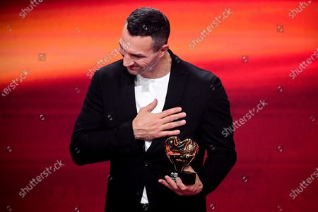 Stock Image of Former Ukrainian boxing heavyweight champion Wladimir Klitschko reacts as he is honored with the golden heart for his extraordinary commitment to children during the 'Ein Herz Fuer Kinder' (lit: A Heart for Children) gala show in Berlin, Germany, 05 December 2020. German television channel ZDF and newspaper 'Bild' collected donations for children's charity organizations in Germany and the whole world.