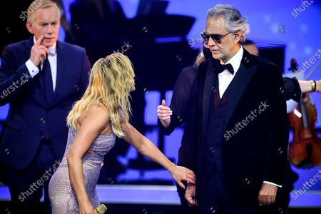 German singer Helene Fischer (C) and Italian opera singer Andrea Bocelli (R) attend the 'Ein Herz Fuer Kinder' (lit: A Heart for Children) gala show in Berlin, Germany, 05 December 2020. German television channel ZDF and newspaper 'Bild' collected donations for children's charity organizations in Germany and the whole world.