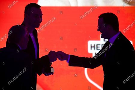 German Health Minister Jens Spahn (R) and former Ukrainian boxing heavyweight champion Wladimir Klitschko (L) fist bump during the 'Ein Herz Fuer Kinder' (lit: A Heart for Children) gala show in Berlin, Germany, 05 December 2020. German television channel ZDF and newspaper 'Bild' collected donations for children's charity organizations in Germany and the whole world.