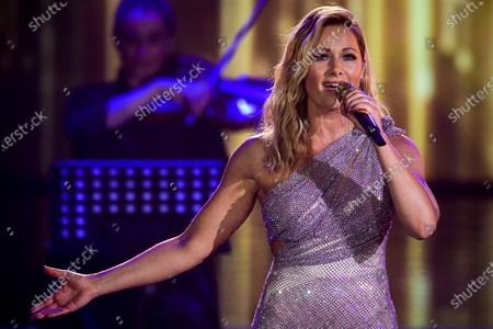 German singer Helene Fischer performs on stage during the 'Ein Herz Fuer Kinder' (lit: A Heart for Children) gala show in Berlin, Germany, 05 December 2020. German television channel ZDF and newspaper 'Bild' collected donations for children's charity organizations in Germany and the whole world.