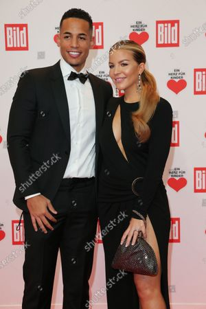 """Stock Image of BERLIN, GERMANY - DECEMBER 05: Ina and Dennis Aogo arrive for the """"Ein Herz Fuer Kinder"""" Gala at Studio Berlin Adlershof on December 05, 2020 in Berlin, Germany. (Photo by Gisela Schober/Getty Images)"""