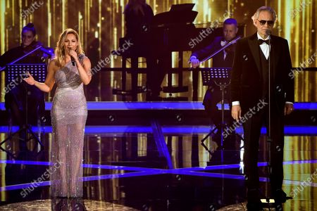 German singer Helene Fischer (L) and Italian opera singer Andrea Bocelli (R) perform on stage during the 'Ein Herz Fuer Kinder' (lit: A Heart for Children) gala show in Berlin, Germany, 05 December 2020. German television channel ZDF and newspaper 'Bild' collected donations for children's charity organizations in Germany and the whole world.