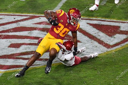 Los Angeles, CA.USC Trojans running back Stephen Carr #7 runs in action during the first quarter the NCAA Football game between the USC Trojans and the Washington State Cougars at the Coliseum in Los Angeles, California..Mandatory Photo Credit: Louis Lopez/CSM