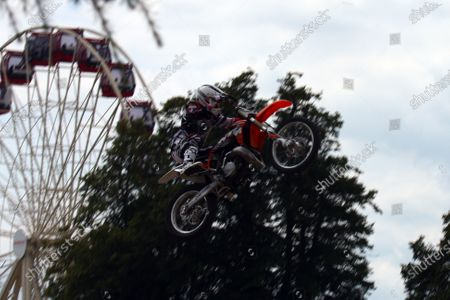 Stock Picture of Goodwood Estate, West Sussex. 30th June - 3rd July 2011 A stunt rider leaps into the air. Atmosphere. World Copyright: Lord Hutton/LAT Photographic