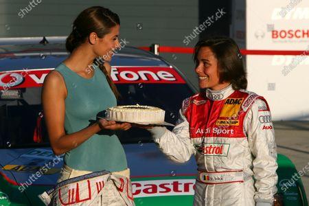 2007 DTM Championship. Round 3, Eurospeedway Lausitz (Lausitzring). 18th - 20th May 2007. Vanina Ickx (BEL), TME, Portrait (right), hands Lara Croft (Karima Adebibe) a birthday cake World Copyright: Miltenburg/xpb cc/LAT
