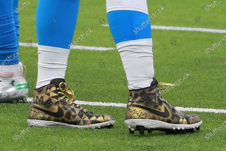 Los Angeles Chargers defensive end Joey Bosa (97) wear his MCMC cleats during an NFL football game against the New England Patriots, in Inglewood, Calif