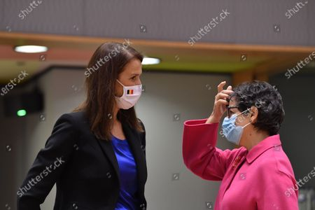 Belgian Foreign minister Sophie Wilmes (L) chats with Spanish Foreign Minister Arancha Gonzalez Laya (R) at the start of the European Foreign Ministers Council in Brussels, Belgium, 07 December 2020. Ministers will mainly focus on transatlantic relations, strategic autonomy and the Hong Kong Security Law.