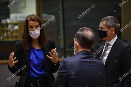 Stock Photo of Belgian Foreign minister Sophie Wilmes (L) chats with German Minister of Foreign Affairs Heiko Maas (C) at the start of the European Foreign Ministers Council in Brussels, Belgium, 07 December 2020. Ministers will mainly focus on transatlantic relations, strategic autonomy and the Hong Kong Security Law.
