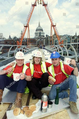 Tv Chef Allegra Mcevedy Entertains Builders On The Millennium Bridge To Chivvy Them Along To Finish The Bridge On Time For The Save The Children's Walk.