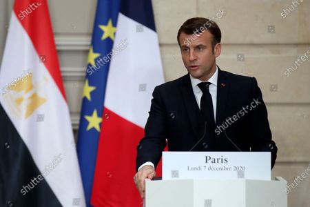 French President Emmanuel Macron speaks during a joint press conference with Egyptian President Abdel-Fattah el-Sissi at the Elysee palace, in Paris. Egyptian President Abdel-Fattah el-Sissi was meeting Monday with French President Emmanuel Macron for talks on fighting terrorism, the conflict in Libya and other regional issues as part of a state visit to France, amid criticism from human rights groups over the Egyptian leader's crackdown on dissent