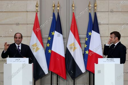 French President Emmanuel Macron, right, and Egyptian President Abdel-Fattah el-Sissi attend a joint press conference at the Elysee palace, in Paris. Egyptian President Abdel-Fattah el-Sissi was meeting Monday with French President Emmanuel Macron for talks on fighting terrorism, the conflict in Libya and other regional issues as part of a state visit to France, amid criticism from human rights groups over the Egyptian leader's crackdown on dissent