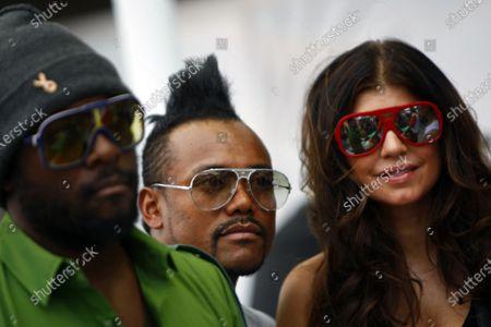 Marina Bay Circuit, Singapore. 26th September 2009. will.i am, apl.de ap and Fergie of the Black Eyed Peas. VIPs. World Copyright: Lorenzo Bellanca/LAT Photographic