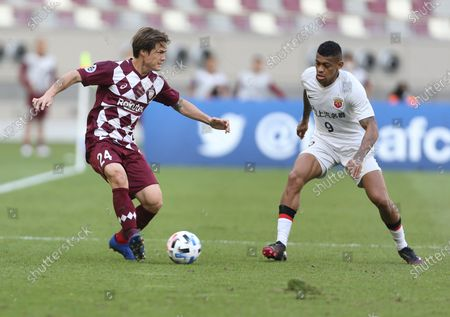 Vissel Kobe's Gotoku Sakai, left, and Shanghai SIPG's Ricardo Lopes fight for the ball during a round of 16 AFC Champions League match in Doha, Qatar