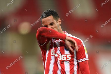 Thomas Ince of Stoke City shows a look of dejection as he leaves the field.
