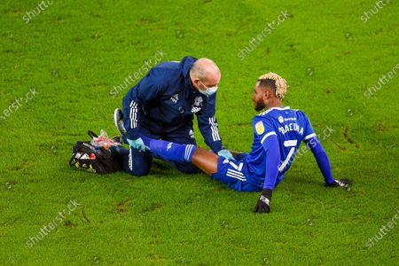 Leandro Bacuna of Cardiff City receives treatment.
