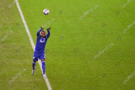 Leandro Bacuna of Cardiff City takes a throw in.