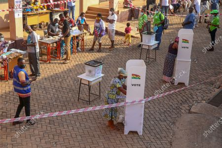 Stock Photo of A woman casts her vote during presidential and parliamentary elections in Kyebi, Ghana, 07 December 2020. National Democratic Congress candidate John Dramani Mahama and ex-President and New Patriotic Party candidate Nana Akufo Addo are the two presidential front-runners among a dozen candidates in the Ghanaian presidential election.